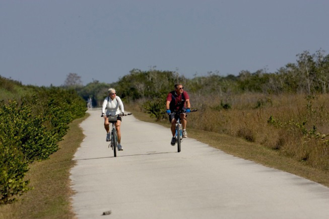Man & Woman riding bike through Shark Valley